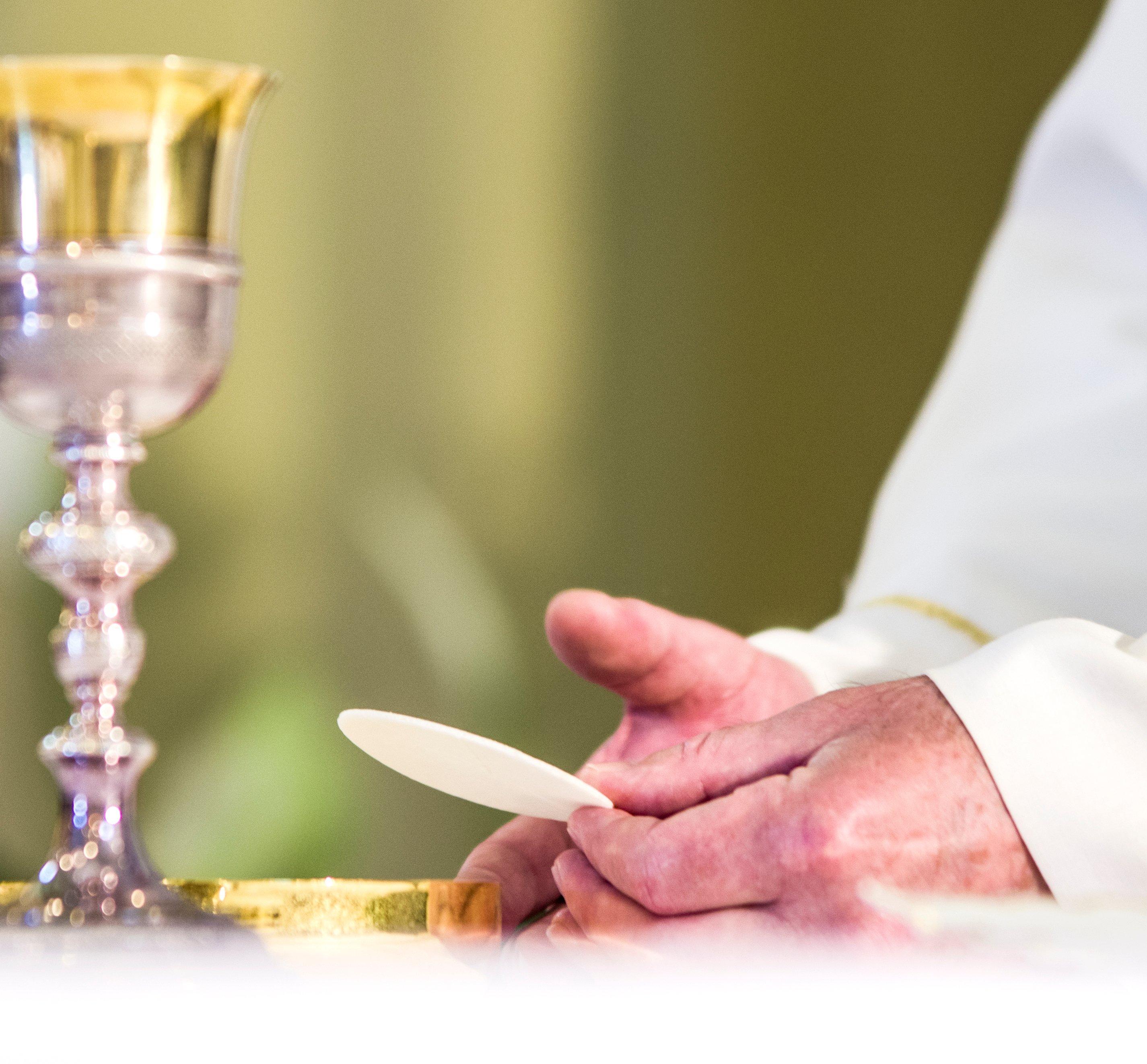 Elderly Priests Hands