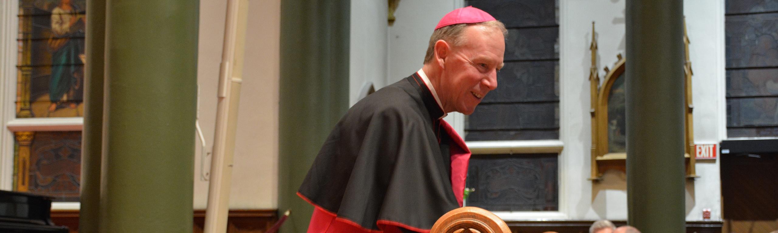 bishop-gary-greeting-parishioner